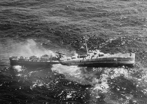 Destroyer Escort USS Fiske broken in two and sinking in the North Atlantic after being torpedoed by the German submarine U-804, 2 August 1944.