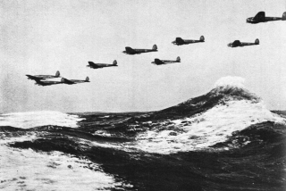 Heinkel He 111 bombers escaping radar detection fly perilously low over the English Channel 1940