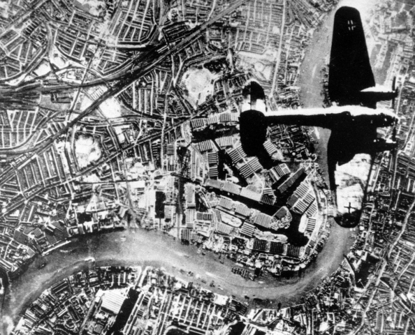 He 111 bomber flies over the Thames River, London, autumn,1940-01