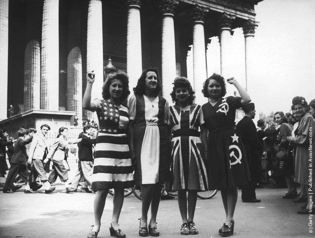 A group of women wearing dresses representing flags of the Allied powers