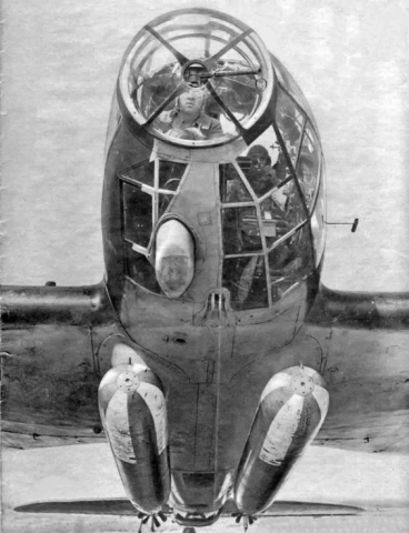 German Heinkel He 111J-1 bomber seen with its crew and torpedoes